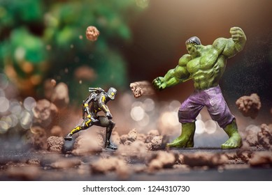 BATAM, INDONESIA - 3/17/2018: Miniature hero Ant-Man fights with the Hulk. This is the name of a fictional character that appears in comic books published by Marvel. Editorial illustration.