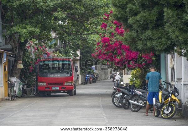 Batanes, Phillipines-March 26, 2015:Unidentified local people with daily life and activities at the one of the street in Batanes Island. Majority people in the island are Ivatan Ethnic.