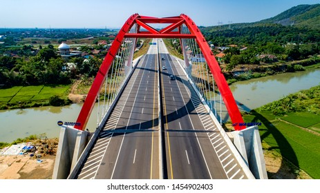 Batang, Central Java / Indonesia - July 1, 2019: Scenic Aerial View of Kalikuto Bridge, an Iconic Red Bridge at Trans Java Toll Road