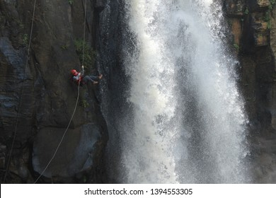 Batang, Jawa Tengah, Indonesia - November 4 2016  The girl rappelling down the waterfall