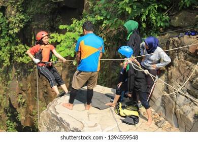Batang, Jawa Tengah, Indonesia - November 4 2016  People prepares rappelling down to the cliff