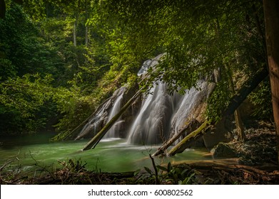 Batanta Island Waterfall, Indonesia. After a one hour hike through rain forest you come to spectacular 60+ meter waterfall located on Batanta Island in the Raja Ampat area of West Papua, Indonesia.