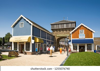 Batavia Stad, Holland, 2012-07-23. Entrance of outlet shopping mall on a sunny day