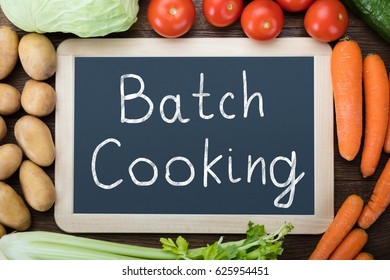 Batch Cooking Written On Slate With Various Vegetables On Table