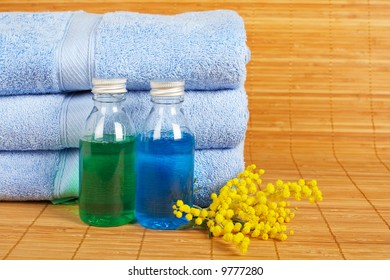 Bath accessories and beauty products on bamboo mat background. Shallow DOF