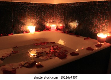 bath with candles and flowers