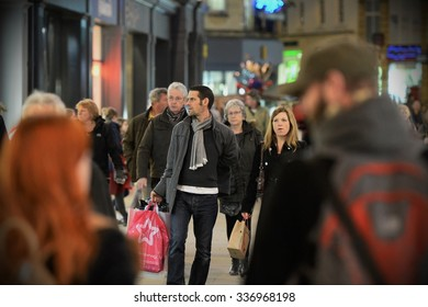 BATH - DEC 19: People walk along a street in the city's shopping district on Dec 19, 2014 in Bath, UK. Stores reported busy trade with only 5 days left of Christmas shopping season.