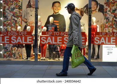 BATH - DEC 25: People visit stores in Southgate shopping district for the Boxing Day Sales on Dec 25, 2014 in Bath, UK. Many shops across the country traditionally hold sales on Boxing Day.