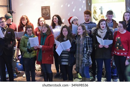 BATH - DEC 9: A choir sing carols at the Christmas Market in the streets surrounding Bath Abbey on Dec 9, 2015 in Bath, UK. The market is held annually in the historic Unesco World Heritage City.