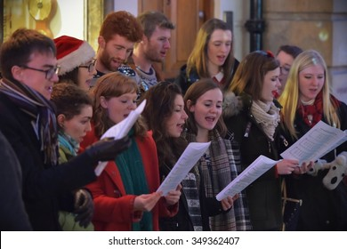 BATH - DEC 9: People sing carols at the Christmas Market in the streets surrounding Bath Abbey on Dec 9, 2015 in Bath, UK. The market is held annually in the historic Unesco World Heritage City.