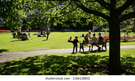 BATH / ENGLAND - JULY 02 2016: People Resting at Park by the River Avon