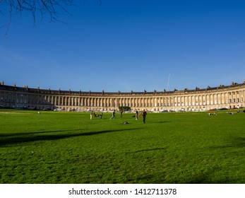 Bath, England - March 25, 2019: View of the Royal Crescent with the green Victoria Park.