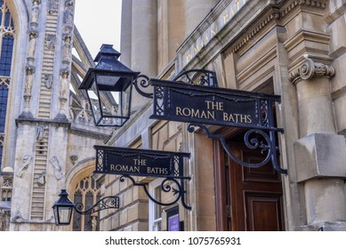 Bath, England - May 19, 2014, Iron signs for the Roman Baths of Bath England in front of the Abbey