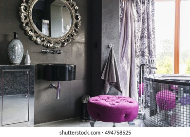 Bath with glassy walls and round old-fashioned mirrow