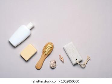 Bath Items Concept, Soap, Shampoo or Shower Gel, Hair Brush, Pumice Stone, Top View, Flat Lay