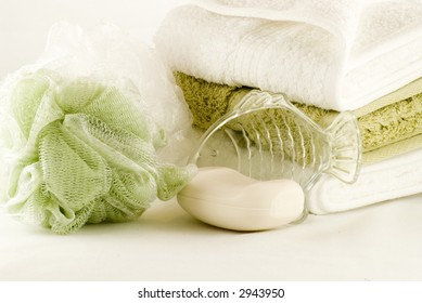Bath items with soap, fish soap dish, sponge and towels