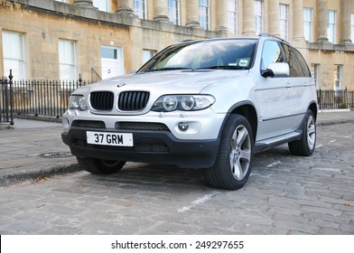 BATH - JUL 26: View of a BMW X5 3.0i on the landmark Royal Crescent on Jul 26, 2010 in Bath, UK. The X5 is a mid-sized luxury SUV manufactured by BMW since 1999 to the present.