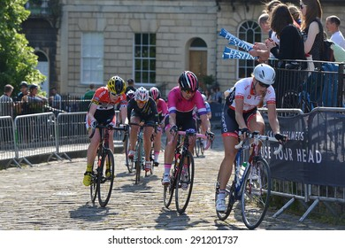 BATH - JUN 11: The peleton rides in the Pearl Izumi Tour Series bicycle race final on Jun 11, 2015 in Bath, UK. The event drew thousands of spectators to the streets of the picturesque Somerset city.