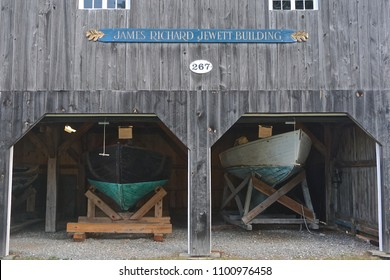 Bath, Maine / USA - September 8, 2017: Examples of small fishing boats on display in the James Richard Jewett Building at the Maine Maritime Museum.