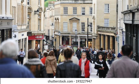 BATH - MAY 1: Unidentified people walk along a busy street on May 1, 2014 in Bath, UK. Bath is a UNESCO World Heritage city and popular travel destination with over 3.8 million visitors per year.