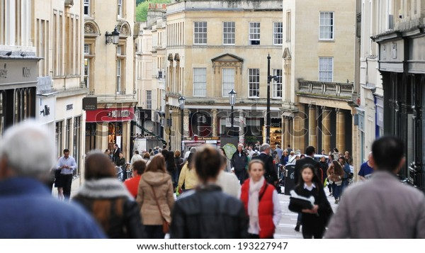 BATH - MAY 1: Unidentified people walk along a busy shopping street. Bath is a UNESCO World Heritage city and popular travel destination with over 3.8 million visitors per year.