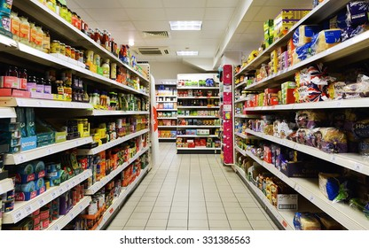 BATH - OCT 20: Aisle view of a Tesco supermarket store on Oct 20, 2015 in Bath, UK. Tesco is the world's second largest retailer with 7,817 stores worldwide and a revenue of £62.3 billion in 2015.