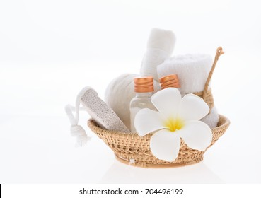 Bath products and skincare treatment with Plumeria spa flower on white background