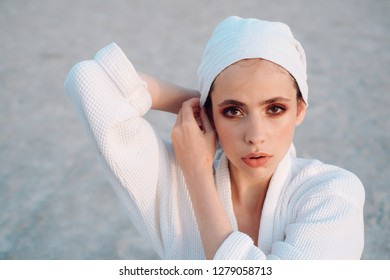 Bath relaxation. Beauty salon. Young woman in bathing gown. Pretty woman wear bath towel on head. Skincare model after spa bath. Skincare at spa. Beauty routine and hygiene care. Bathing habits.