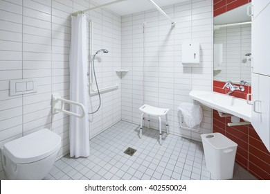 bath room of a hospital ward empty with toilet and shower