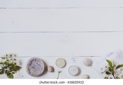 Bath salt and flowers on wooden background. Top view