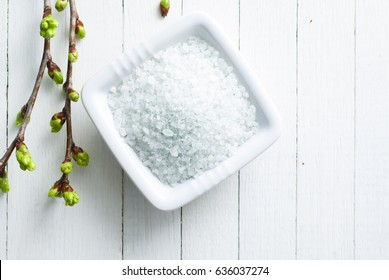 bath salt on white wood table