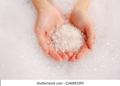 Bath salts in hand. Aromatic spa set with sea salt and soap
