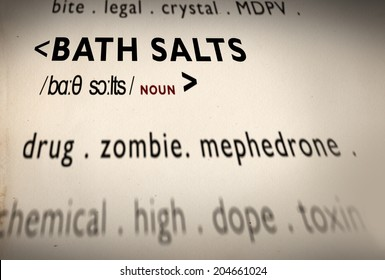 Bath Salts term written in dictionary definition of the dangerous legal substance known as the zombie drug and words related such as toxine, dope, crystal, chemical substance