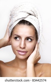 Bath scene - fresh clean female face with towel on her head