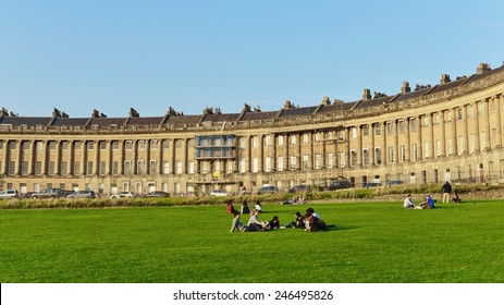 BATH - SEP 12: People gather in the warm evening sun in Victoria Park at the landmark Royal Crescent on Sep 12, 2014 in Bath, UK. Bath is a UNESCO World Heritage city with 4.5mln visitors a year.