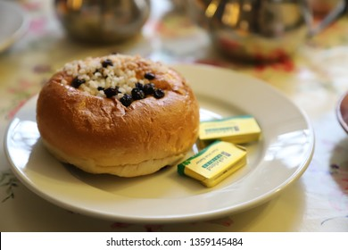 Bath, Somerset, England: March 2019 - The Bath Bun is a sweet roll made from a milk-based yeast dough with crushed sugar sprinkled on top after baking.