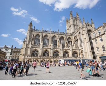 Bath, Somerset / UK - July 14 2018: Tourists in Kingston Parade in front of Bath Abbey