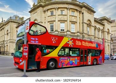 Bath, Somerset / UK - March 14 2018: A Bath City Hop On Hop Off Sightseeing Open Top Double-Decker Tour Bus