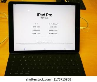 Bath, Somerset, UK, Sept 2018. Apple laptop latest ipad pro 2018 edition on wooden background.