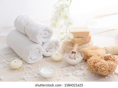 bath spa treatment composition on wooden with pile of white stones texture background