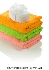 bath sponge on towels