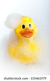 Bath time rubber duck in foam bath