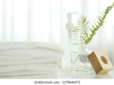 Bath towels beautifully folded on a white table