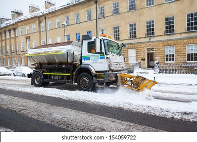 BATH, UK - 18 JANUARY : A council truck clears snow and spreads salt on Great Pulteney Street in Bath, UK on 18th Jan 2013. The street is an important thoroughfare in Bath city centre.