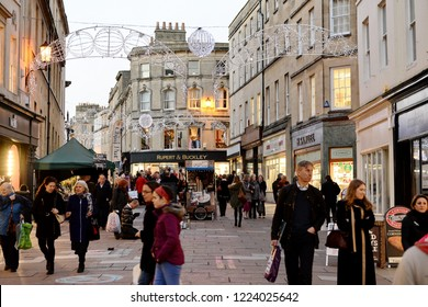Bath, UK - December 19, 2018: People walk along a street in the city's shopping district. Stores reported busy trade with only 5 days left of the Christmas shopping season.