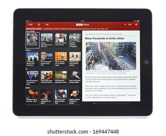 BATH, UK - DECEMBER 2, 2011: An Apple iPad displaying the front page of the BBC News App, against a white background. The app can be used to read the latest stories or watch a BBC News live stream.