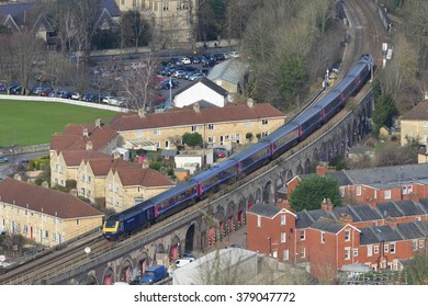 BATH, UK - FEB 16, 2016: A Great Western Railway (GWR) train runs on tracks through the city on the Wessex Main Line. GWR operate a fleet of over 250 trains calling at 270 stations.