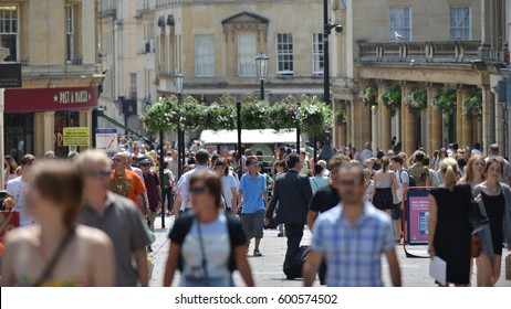 Bath, UK - July 23, 2014: Tourists and locals walk along a city centre street on a sunny day. The Somerset city of Bath has UNESCO World Heritage status and receives over 4 million visitors each year.