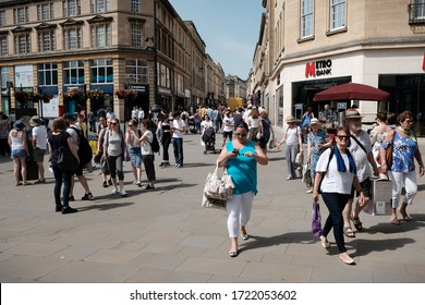 Bath, UK - June 26, 2019: People walk on a busy street in Southgate shopping district. The Somerset city of Bath is a famous UNESCO World Heritage status site, with over 4 million visitors per year.