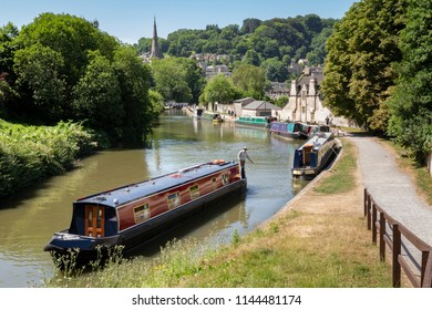 BATH, UK - JUNE 30, 2018 : Narrow Boats on the Kennet and Avon canal in Widcombe in the city of Bath.